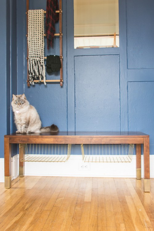 Need more entryway storage? This easy bench storage hack can help you get organized.
