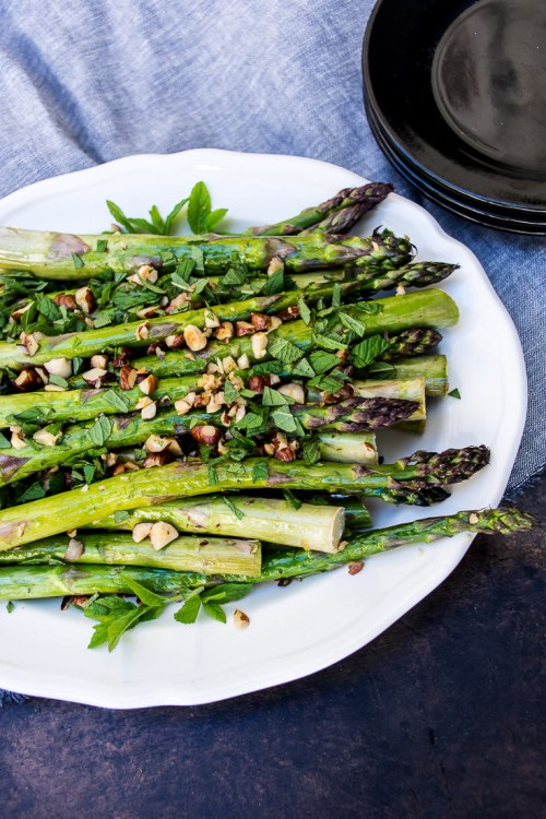 Roasted asparagus with hazelnuts and mint is a refreshingly different side dish that's perfect for celebrating spring flavors.