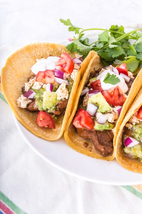 Make these mushroom mole black bean tacos in the slow cooker for an easy, flavorful vegan meal.