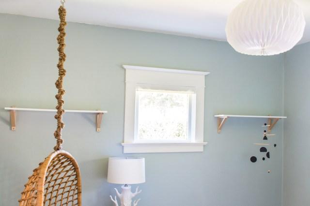 Nursery shelves, hanging chair, and lights