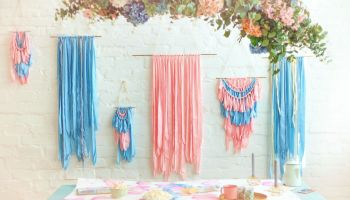 Featured | Pink and blue silk macrame on the white brick wall | DIY Macrame Wall Hanging Ideas