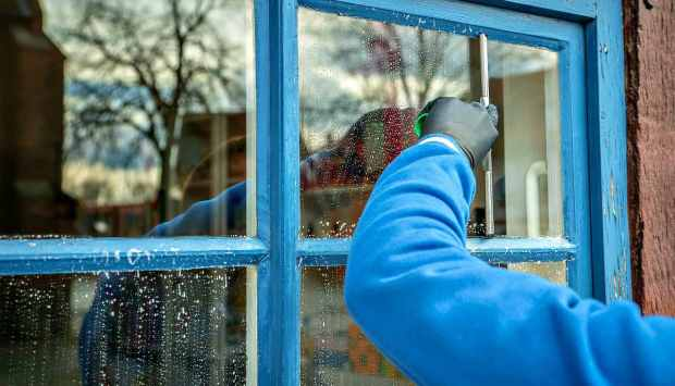 A man cleaning window | DIY Spring Cleaning Tips And Tricks