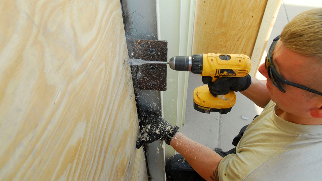 How to Drill a Hole in a Door Frame