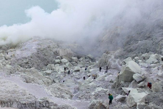 Sulphuric gas over tourists on Mt Ijen