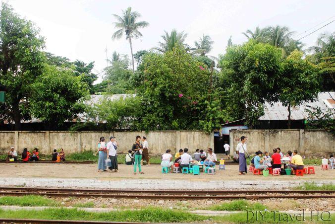 People waiting on train tracks