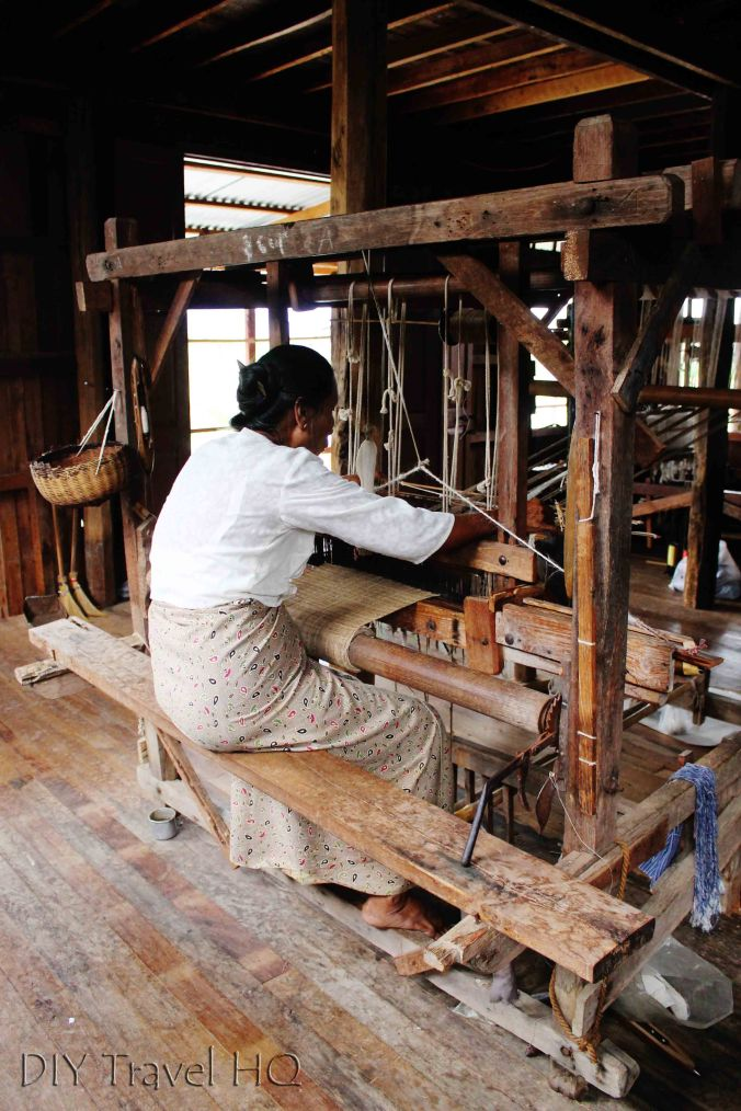 Woman lotus weaving on Inle Lake