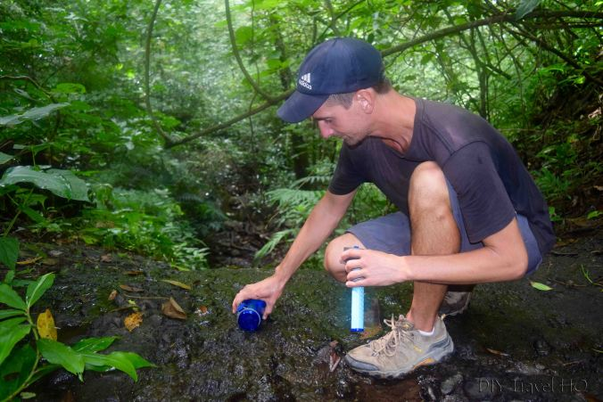 El Imposible National Park Filling LifeStraw with Stream Water