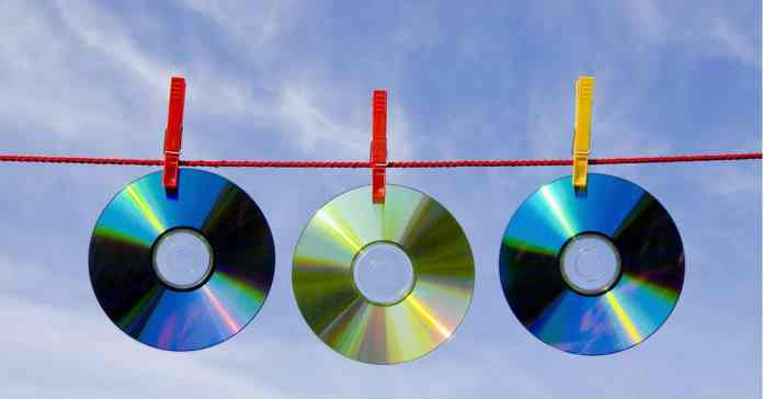 CD, DVD discs hanging out to dry as if having been cleaned.