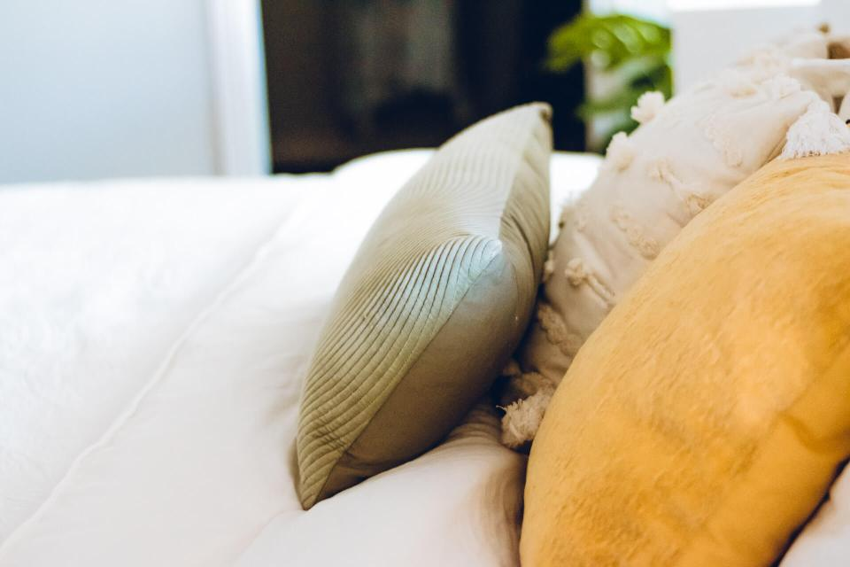 Side view of pillows on a bed
