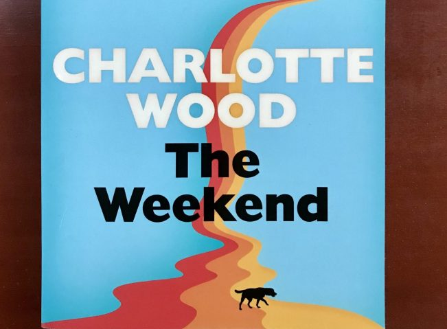 Book cover of The Weekend by Charlotte Wood including the silhouette of a dog