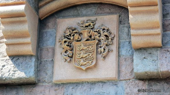 Closeup of Disney Family Coat of Arms or crest on Sleeping Beauty Castle in Disneyland Anaheim CA
