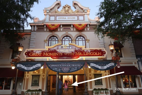 Disneyland Opera House in Town Square at dusk with lights coming on
