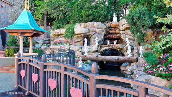 Snow White Grotto in Disneyland with wishing well in foreground