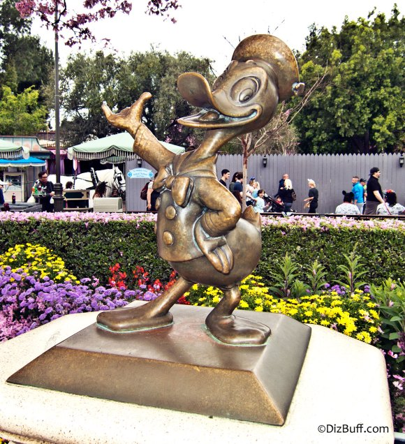 Little Donald Duck statue near Disneyland Partners Statue in Central Hub or Central Plaza or Castle Hub