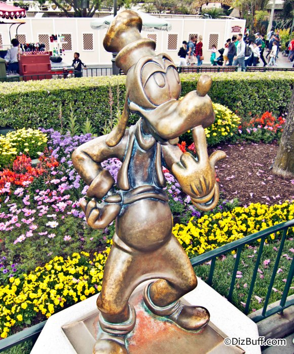 Little Goofy statue near Disneyland Partners Statue in Central Hub or Central Plaza or Castle Hub