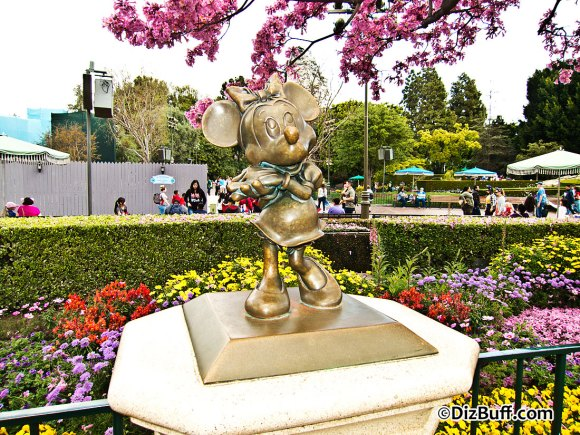 Little Minnie Mouse statue near Disneyland Partners Statue in Central Hub or Central Plaza or Castle Hub