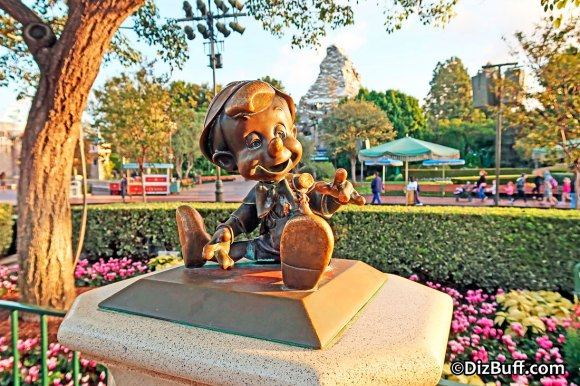 Little Pinnochio statue near Disneyland Partners Statue in Central Hub or Central Plaza or Castle Hub