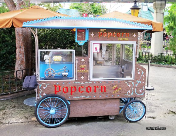 Popcorn Cart with Abominable Snowman Yeti Popcorn turner at Disneyland near the Matterhorn
