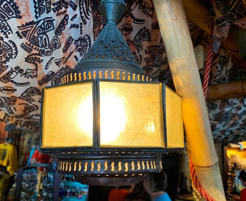 Metal and glass light fixture at Adventurland Bazaar Store in Disneyland CA