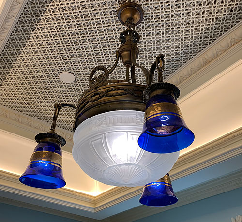 Blue and white glass ceiling light fixture in Disneyland Club 33