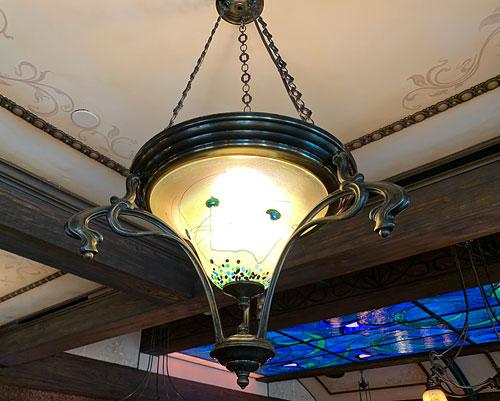 Indirect lighting fixture with artwork at Disneyland Club 33