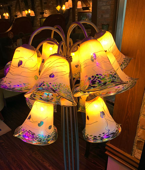 Hand painted floor lamp with multiple light fixtures at Disneyland Club 33