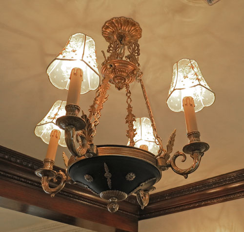 Ceiling light fixture in candle style at Disneyland Club 33