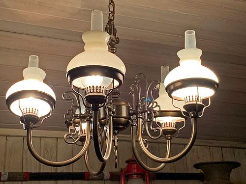 Light fixture hanging in Crockett and Russel Hat Co in Disneyland Frontierland