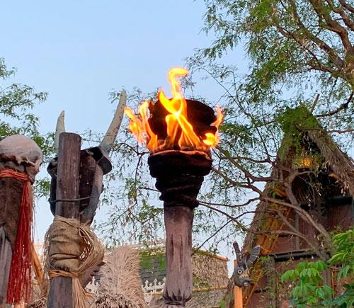 Tiki torch flame light fixture at Enchanted Tiki Room in Adventureland Disneyland