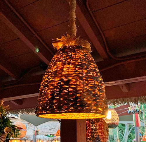 Tropical hanging straw light fixture at Enchanted Tiki Room Disneyland Adventureland