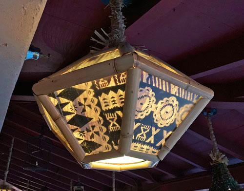 Hanging light fixture in Enchanted Tiki Room outer porch in Adventureland Disneyland