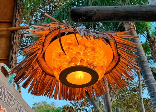 Straw and shell light fixture at Enchanted Tiki Room in Adventureland Disneyland