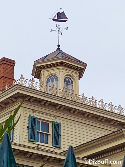 Schooner sailing ship weather vane on roof of Haunted Mansion in Disneyland
