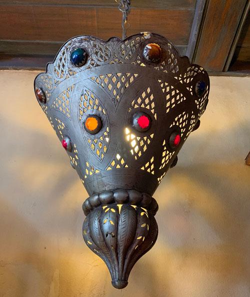 Metal and jewel studded light fixture in Pieces of Eight Shop in Disneyland