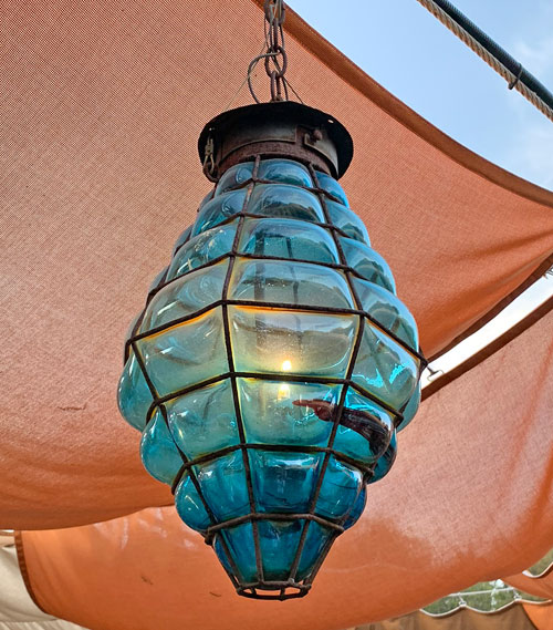 Blue beehive shaped light fixture at Rancho del Zocalo Restaurant in Disneyland Frontierland