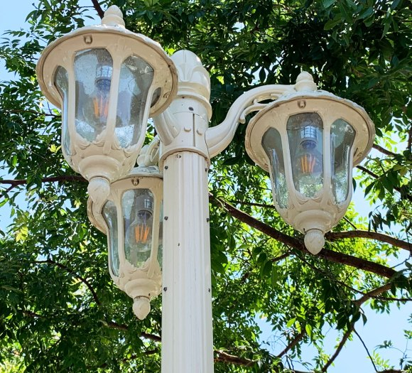 Triple white glass and metal light fixtures at River Belle Terrace Restaurant Disneyland Frontierland
