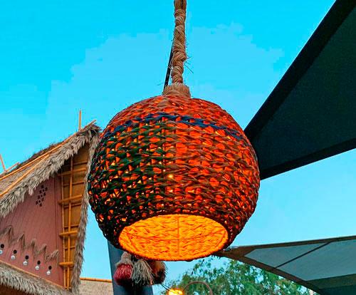 Tropical woven straw light fixture at The Tropical Hideaway in Disneyland Adventureland