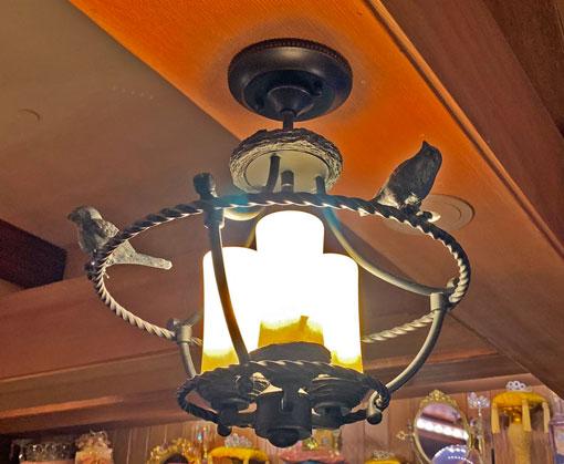 Perching bird light fixture in Bibbidi Bobbidi Boutique at Fantasyland Disneyland