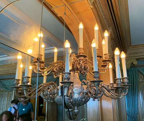 Wall mounted candle style light fixture in Blue Bayou foyer in New Orleans Square Disneyland