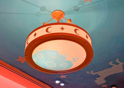 Round Light fixture with crescent moons on ceiling of Elias and Company in Disney California Adventure Park