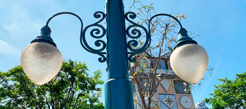 Twin glass light fixtures near It's a Small World attraction in Disneyland