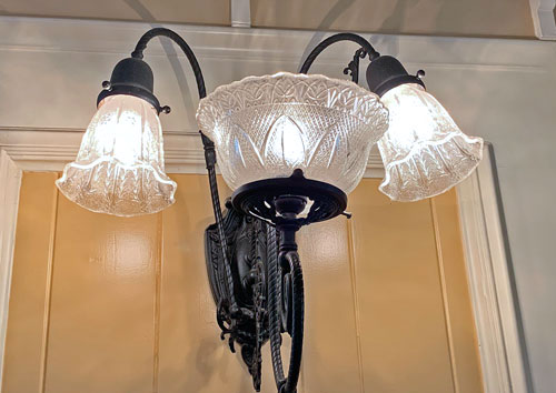 Wall sconce light fixture at Jolly Holiday Bakery Cafe in Disneyland CA
