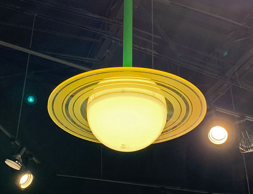 Saturn shaped light fixture with rings in Little Green Men Command Store in Tomorrowland Disneyland