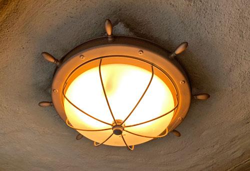 Nautical Light fixture shaped like a ship's wheel or helm in Peter Pan's Flight Disneyland
