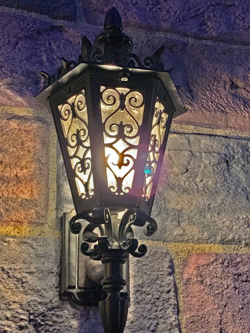 wrought iron light fixture on exterior of Sleeping Beauty Castle in Fantasyland Disneyland