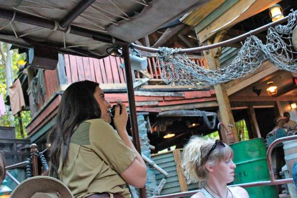Skipper on river boat on Jungle Cruise with microphone