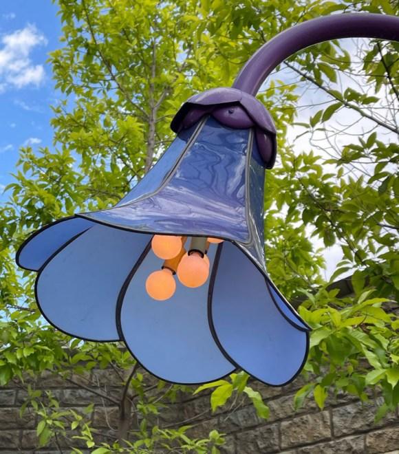 Blue flower light fixture at Alice in Wonderland in Disneyland CA