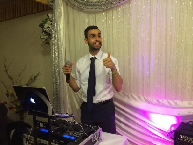 DJ Alex Reyes performing at a Quinceanera