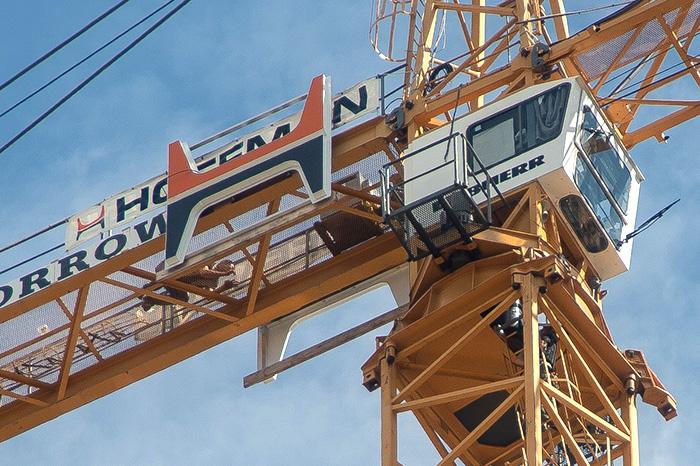 updated man climbs crane