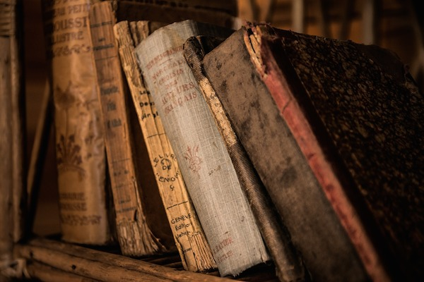 old brown books on shelf
